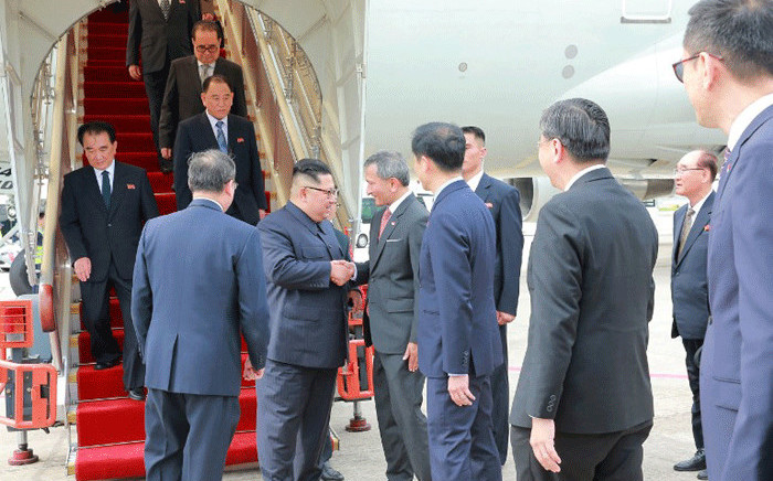 In this picture taken on June 10, 2018 and released from North Korea's official Korean Central News Agency (KCNA) on June 11, 2018, North Korean leader (centre L) is greeted by Singapore's Foreign Minister Vivian Balakrishnan (centre R) upon his arrival in Singapore. Picture: AFP.
