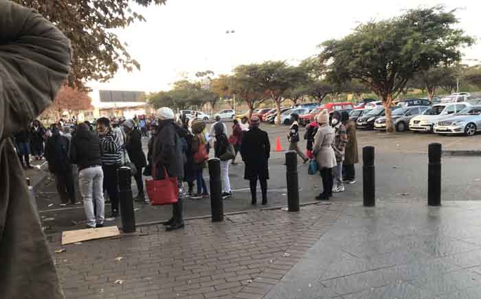 The lengthy queue at the Maponya Mall Sassa office where some people have been waiting since the night before in order to get their social grants. Picture: Kgomotso Modise/EWN