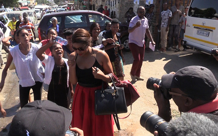 Angry Alexandra residents hurl insults at the sister of murder accused Sindisiwe Manqele, during her first court appearance, Tuesday 10 March 2015. Picture: Vumani Mkhize/EWN.