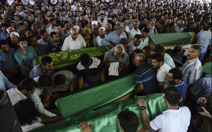 People gather for the funeral of victims of last night's attack on a wedding party that left 51 dead in Gaziantep in southeastern Turkey near the Syrian border on August 21, 2016. Picture: AFP.