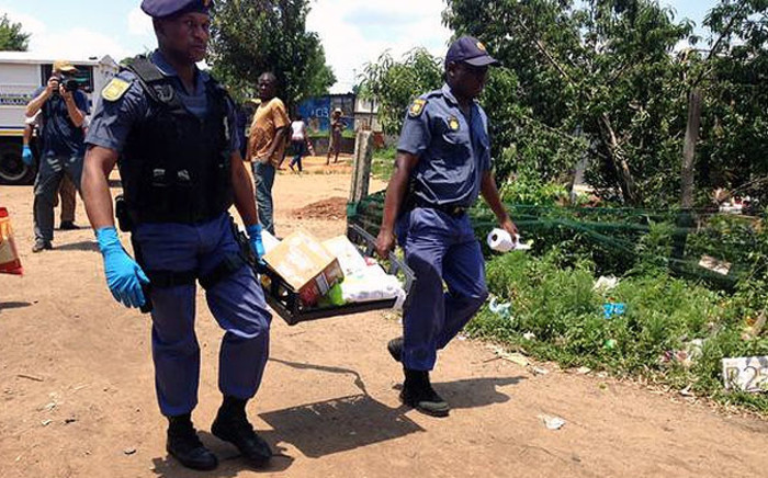 Police continue to seize stolen goods from a spaza shop in Langlaagte on 26 January, 2015. Picture: Gia Nicolaides/EWN.
