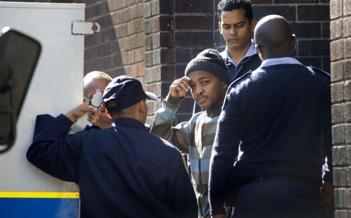 Mziwamdoda Qwabe leaves the Wynberg Magistrates Court in 2011, following his arrest for the murder of Anni Dewani