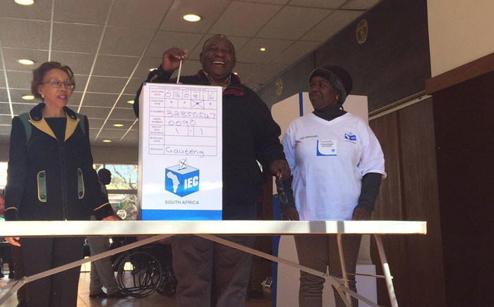 FILE: Then deputy president Cyril Ramaphosa, seen  here with his wife Tshepo and an IEC official, casts his special vote at the Hyde Park High School on 2 August 2016. Picture: EWN