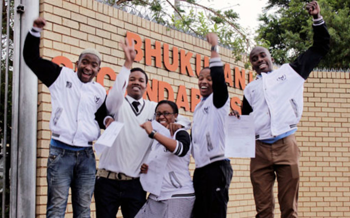 Matriculants from Bhukulani Secondary School in Zondi, Soweto celebrate after receiving their results on 3 January 2013. Picture: Sebabatso Mosamo/EWN