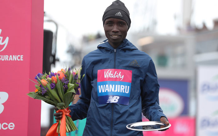 FILE: Second placed Kenya's Daniel Wanjiru poses with his trophy after the half marathon elite men's race during the inaugural The Big Half in London on 4 March 2018. Picture: AFP