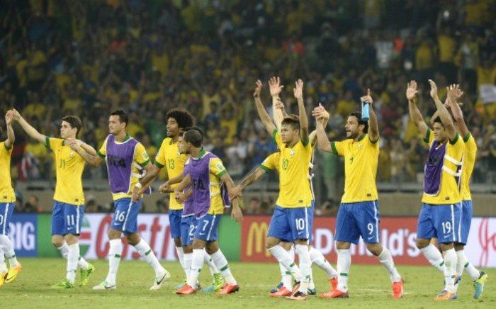 Brazil celebrates after defeating Uruguay in the Confederations Cup semi-final in Belo Horizonte, June 26 2013. Picture: AFP.