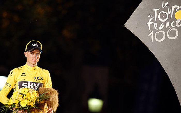 """Tour de France 2013 winner Britain's Chris Froome poses at the end of the 133.5 km 21st and last stage of the 100th edition of the Tour de France cycling race on 21 July 2013. Picture: AFP"""""""