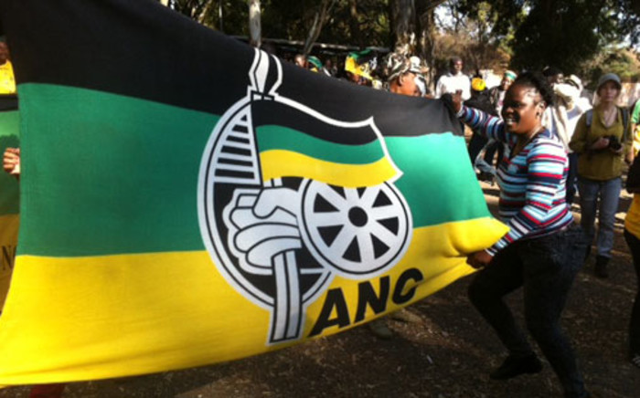 An ANC flag is held up by members. Picture: Taurai Maduna/EWN.