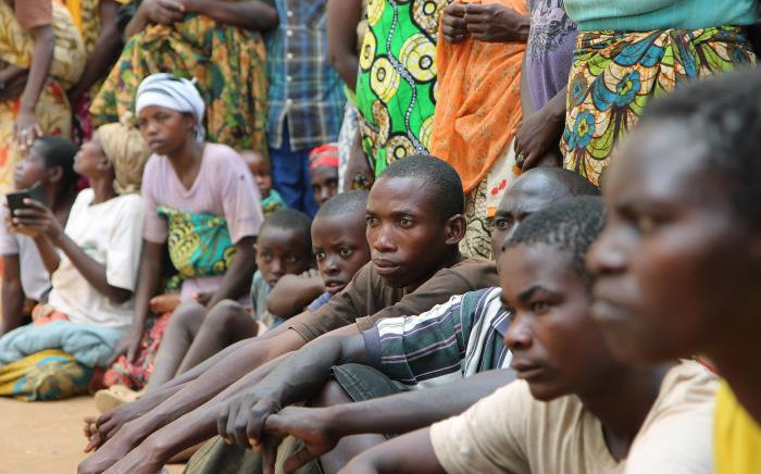 A group of Burundian refugees waits for a soap and blanket distribution at Gashora on Bugesera in 10 April, 2015. Picture: AFP.