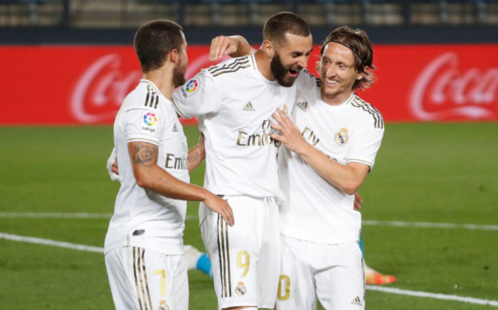 Real Madrid's Karim Benzema (centre) celebrates a goal with his teammates. Picture: @realmadriden/Twitter