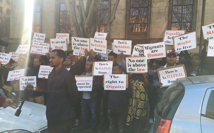 Foreign nationals picketing outside the Joburg Magistrate's Court on Monday, 12 August 2019 in solidarity of their fellow migrants who were arrested during last week's Joburg raids. Picture: Edwin Ntshidi/EWN