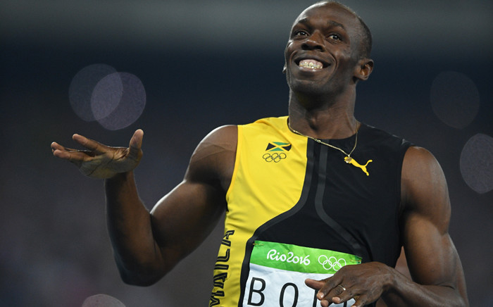 Jamaica's Usain Bolt celebrates after he won the Men's 100m Final during the athletics event at the Rio 2016 Olympic Games at the Olympic Stadium in Rio de Janeiro on 14 August, 2016. Picture: AFP.