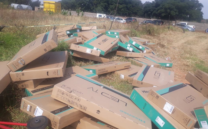 Two men were arrested at Glen Austin, Johannesburg, on 1 April 2019 for allegedly hijacking a truck and stealing TV sets. Picture: @SAPoliceService/Twitter
