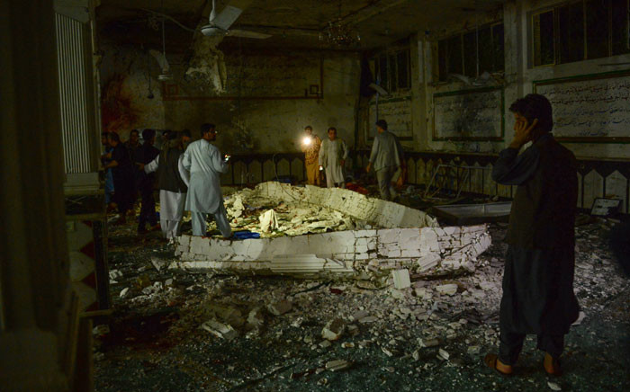 Afghan security personnel inspect the site of a suicide bomb attack at a Shiite mosque in Herat on August 1, 2017. Picture: AFP