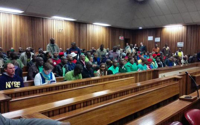 Miners fill the court room as they await judgment for the release of the Marikana report on 15 June 2015. Picture: Kgothatso Mogale/EWN.