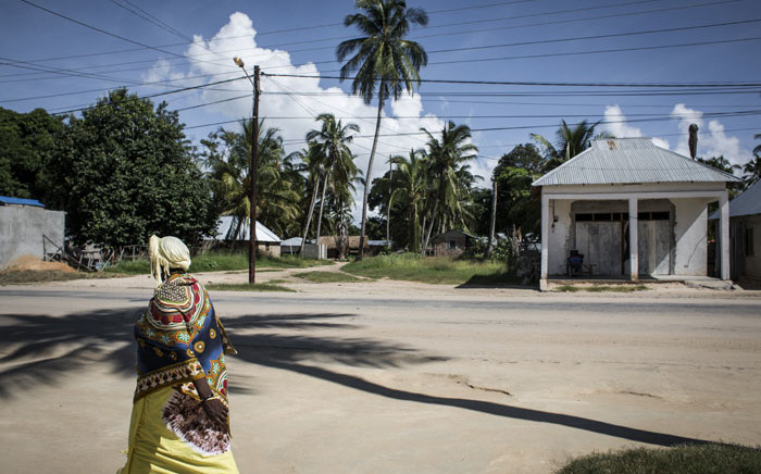 FILE: In this file photo, a Mozambican woman walks in Palma, a small, palm-fringed fishing town meant to become a symbol of Mozambique's glittering future, transformed by one of the world's largest liquefied natural gas projects. Islamist militants have seized control of the northern Mozambique town of Palma, near a huge gas project involving French oil major Total and other international energy companies, security sources said on 27 March 2021. Picture: AFP