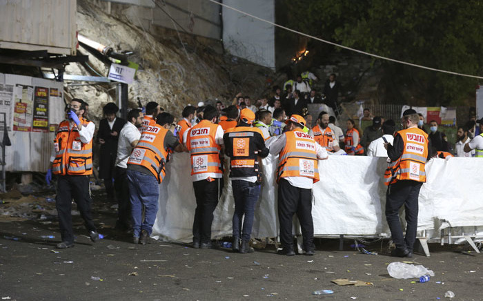 Emergency workers gather at the scene after dozens of people were killed and others injured after a grandstand collapsed in Meron, Israel, where tens of thousands of people were gathered to celebrate the festival of Lag Ba'omer at the site in northern Israel early on 30 April 2021. Picture: David Cohen/AFP