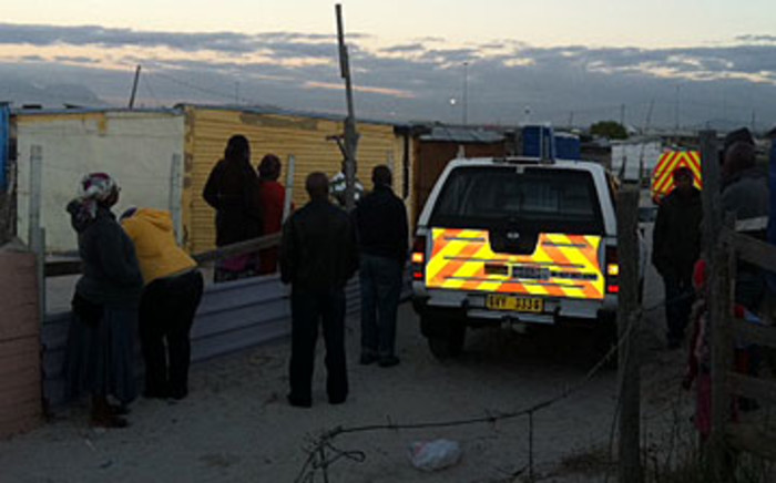 Police forensic teams arrive on the scene after a man killed his family and attempted to end his own life in Khayelitsha on 29 March 2012. Picture: Malungelo Booi/EWN.