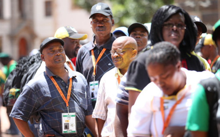 ANC delegates queue in at the party's elective conference in Mangaung on 19 December 2012, to vote in new members into the party's NEC. Picture: Taurai Maduna/EWN.