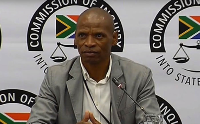 A screengrab of state capture inquiry investigator Patrick Mlambo giving evidence at the commission on 2 April 2019.
