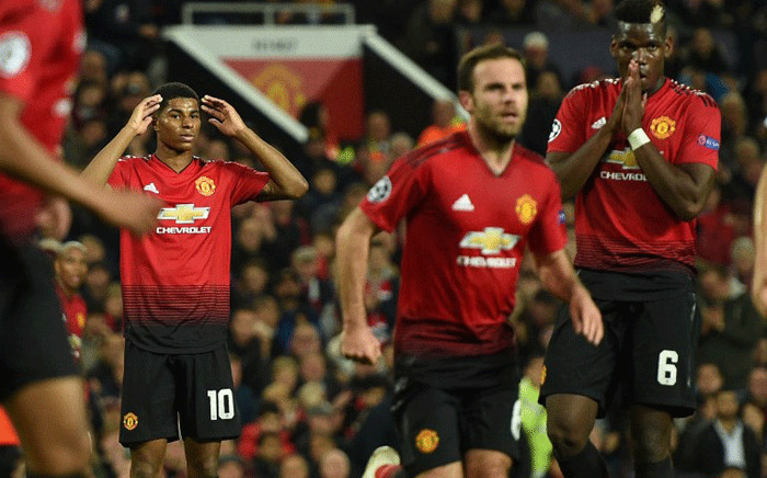 Manchester United's English striker Marcus Rashford and Manchester United's French midfielder Paul Pogba gesture during the Champions League group H football match between Manchester United and Juventus at Old Trafford in Manchester, north west England, on 23 October, 2018. Picture: AFP.