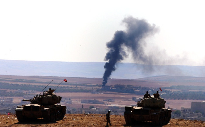 A picture taken from Turkey shows smoke rising after an airstrike by an alleged alliance war plane on the Islamic State targets in the west of Kobani, Syria, where Kurdish fighters YPG are trying to defend the city, near Suruc district, Sanliurfa, Turkey 08 October 2014. Picture: EPA/Sedat Suna.