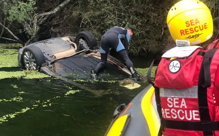 A woman was found dead in a car that was found semi-submerged in Hartebeesport Dam on 8 May 2021. Picture: @NSRI/Twitter.