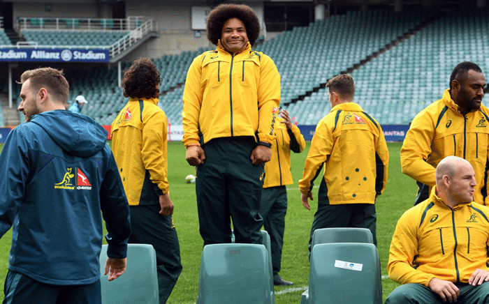 Australian rugby player Tatafu Polota-Nau (C) prepares for the team photo before the team's Captain's Run in Sydney on 16 June 2017. Picture: AFP.