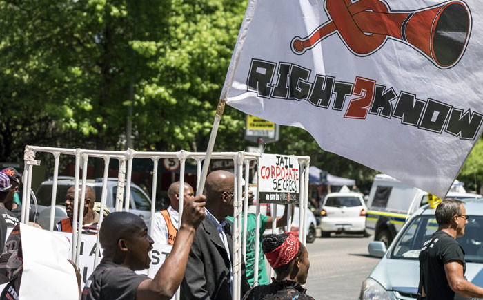 FILE: Supporters of the Right to Know (R2K) campaign picketing outside the Johannesburg Stock Exchange. Picture: Shayne Robinson.