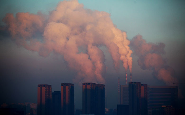 This picture shows a thermal power plant discharging heavy smog into the air in Changchun, northeast China's Jilin province. Picture: AFP