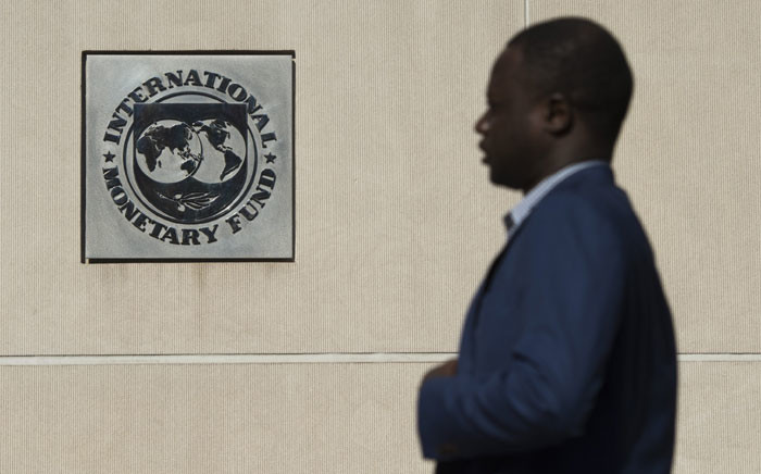 A man walks past the International Monetary Fund (IMF) headquarters in Washington DC on 5 September, 2018. Picture: AFP