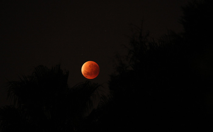Clear skies during the early hours on 28 September allowed South Africans to witness the rare lunar eclipse of a so-called 'blood moon' or 'supermoon'. Picture: Nishaan Desai/iWitness.