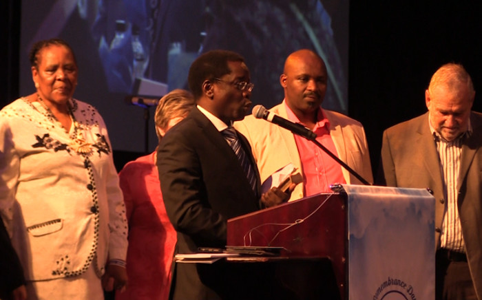 Wiseman Racine reads out a message from Pastor TB Joshua on the commemoration of those who died when a guesthouse belonging to the Synagogue Church of All Nations collapsed In Nigeria exactly one year ago today. Picture: Kgothatso Mogale/EWN.