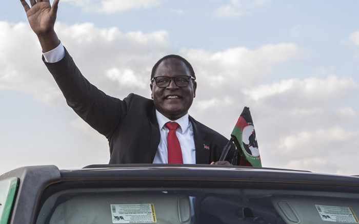 Malawi's main opposition Malawi Congress Party, MCP, Leader Lazarus Chakwera who is leading the Tonse Alliance in the fresh presidential elections due on 23 June 2020 arrives at Mtandire locations in the suburb of the capital Lilongwe to hold his final rally, 20 June 2020. Picture: AFP.