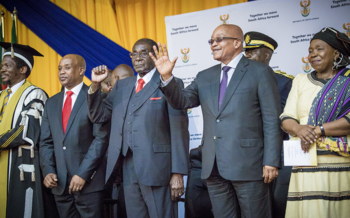 President Jacob Zuma and Zimbabwean President Robert Mugabe made their way through the University of Fort Hare sports complex and onto stage to the singing and cheering of the audience. Picture: Thomas Holder/EWN.