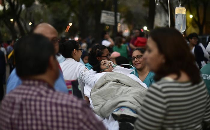 A patient is evacuated from a hospital during a powerful earthquake in Mexico City on 16 February 2018. Picture: AFP.