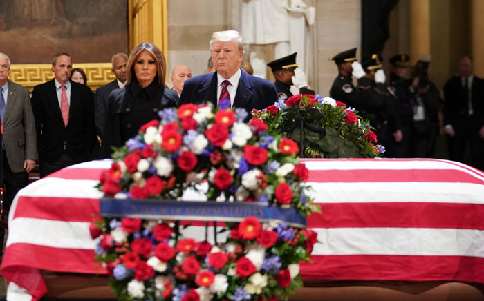 US President Donald Trump and First Lady Melania Trump arrive to pay their respects to former US President George HW Bush as he lies in state in the US Capitol's rotunda 3 December 2018 in Washington, DC. Picture: AFP