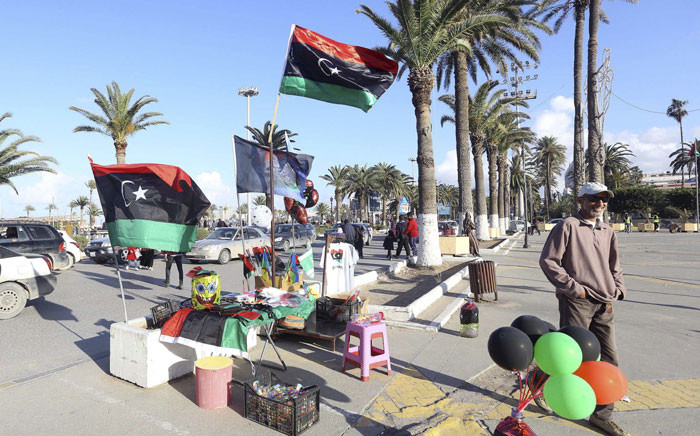FILE: A vendor stands next to his products ahead of the eighth anniversary of the Libyan revolution which toppled late leader and strongman Muammar Gaddafi on 9 February 2019.  Picture: AFP.