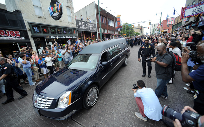 A hearse carrying the body of BB King makes one last trip down Beale Street during the funeral procession in Memphis. Picture: AFP.