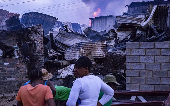 Residents gather their belongings at the scene where a fire broke out at the Alexandra informal settlement on 6 December 2018. Picture: Kayleen Morgan/EWN