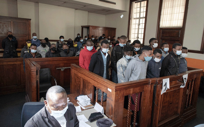 50 suspects appeared in the Johannesburg Central Magistrates Court on 21 July 2021 on various charges including public violence, housebreaking and theft following days of violence and looting in Gauteng. Their case was postponed to 28 July 2021. Picture: Boikhutso Ntsoko/Eyewitness News.