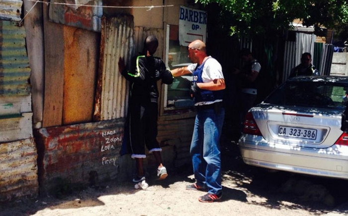 FILE: Cape Town police officers search suspects after gang warfare flares up on the Cape flats. Picture: Shamiela Fisher/EWN