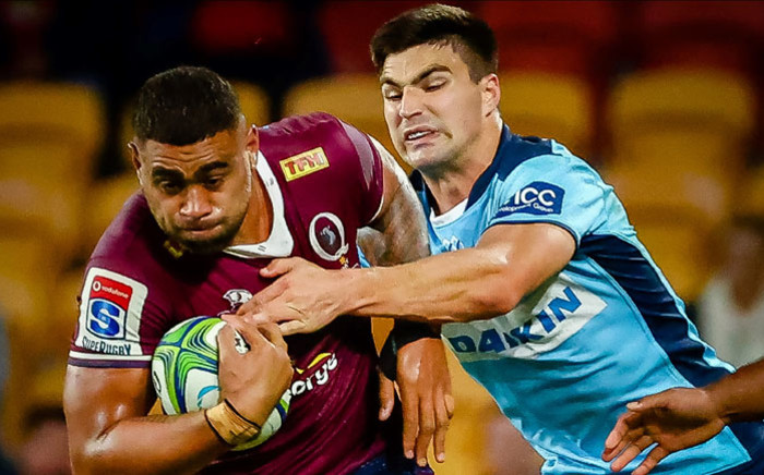 FILE: The Reds' Lukhan Salakaia-Loto (L) is tackled by Waratahs' Jack Maddocks (R) during the Super Rugby match between Australia's Queensland Reds and the New South Wales Waratahs at Suncorp Stadium in Brisbane on 3 July 2020. Picture: AFP