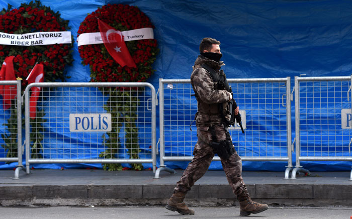 FILE: A Turkish special force police officer patrols in front of the Reina nightclub in Istanbul, three days after a gunman killed 39 people on New Year's Eve. Picture: AFP.