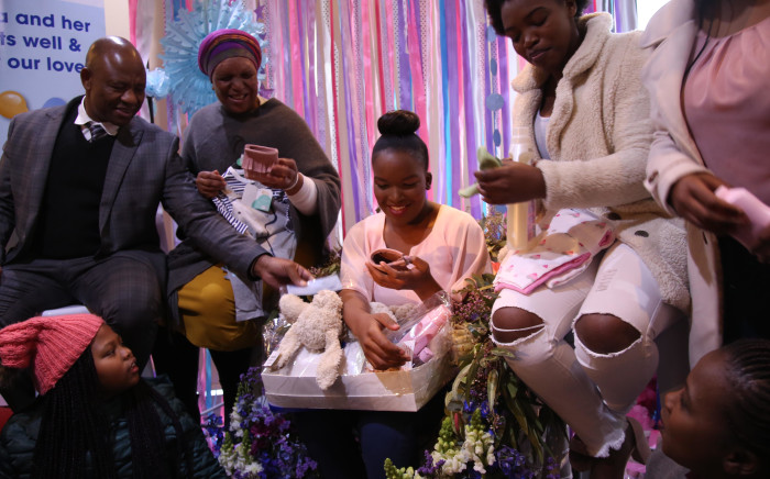 Inga Mafenuka looks at all the gifts she received at her baby shower. Picture: Bertram Malgas