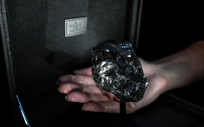 """This picture taken on 21 January 2020, shows the world's second-biggest rough diamond named """"Sewelo"""" displayed at place Vendome's Louis Vuitton luxury shop in Paris. Picture: AFP"""