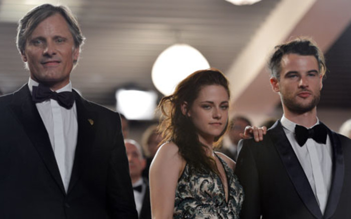 """US actor Viggo Mortensen, US actress Kristen Stewart and British actor Tom Sturridge arrive for the screening of """"On the Road"""" presented in competition at the 65th Cannes film festival on May 23, 2012 in Cannes. Picture: AFP"""