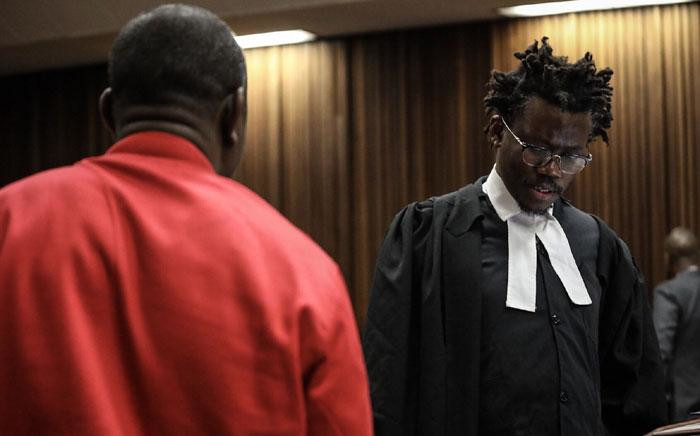 Advocate Tembeka Ngcukaitobi, who represents EFF leader Julius Malema, chats to EFF SG Godrich Gardee at the North Gauteng High Court. Picture: Abigail Javier/EWN