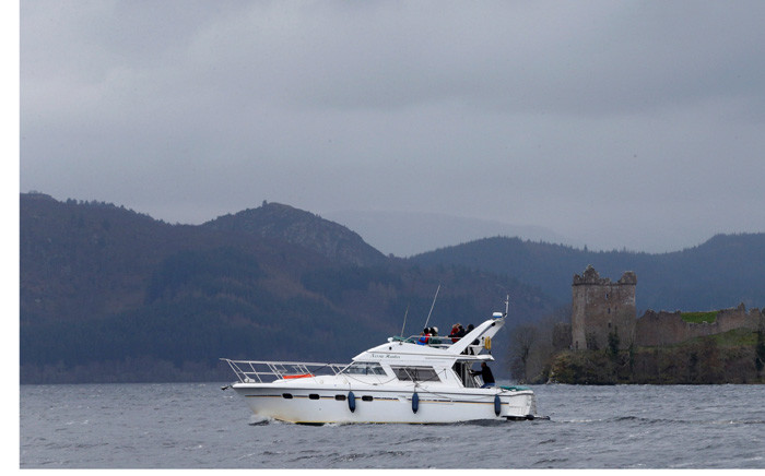 A boat sails in front of Urquhart Castle on Loch Ness in Scotland in 2016. Picture: Reuters