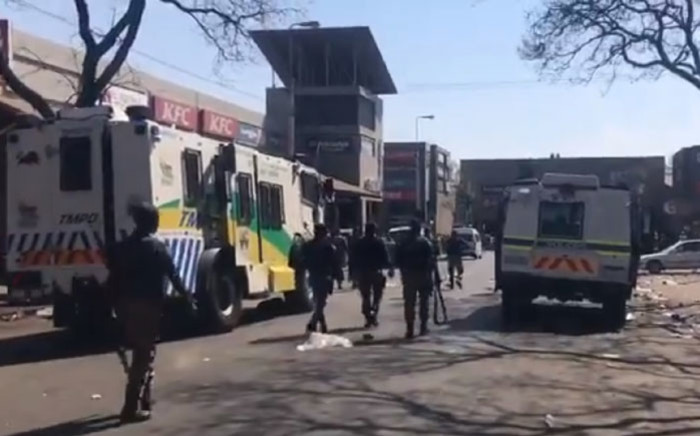 Tshwane Metro Police disperse protesters in the Tshwane CBD on 28 August 2019. Picture: EWN